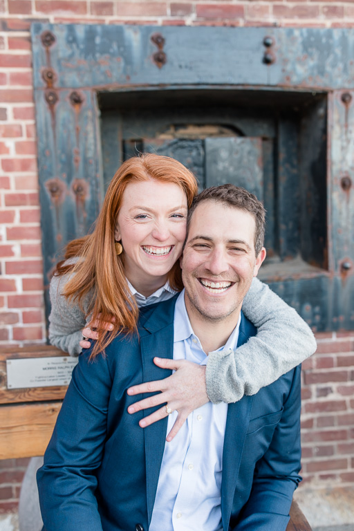 engagement photo by the old fort brick wall in san francisco