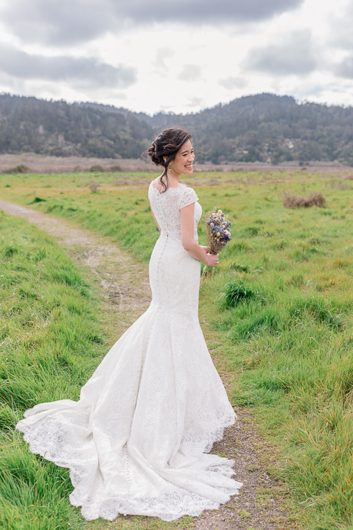 stunning bridal solo portrait on a green field in Point Reyes