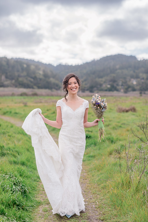 beautiful bride in her lace gown on the Point Reyes Station trail
