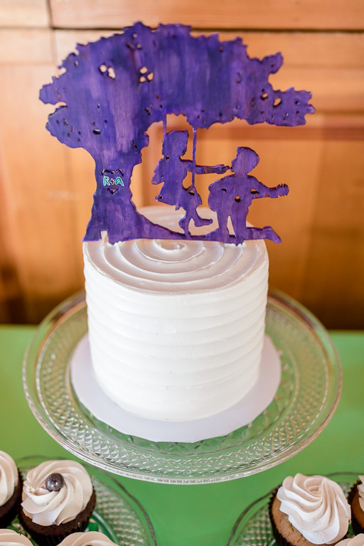 customized cake topper made by a friend of the newlyweds