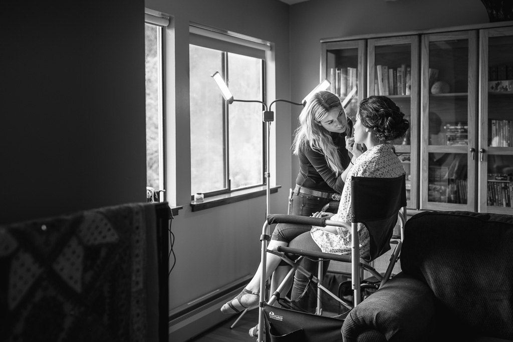 bride having her makeup done at an airbnb