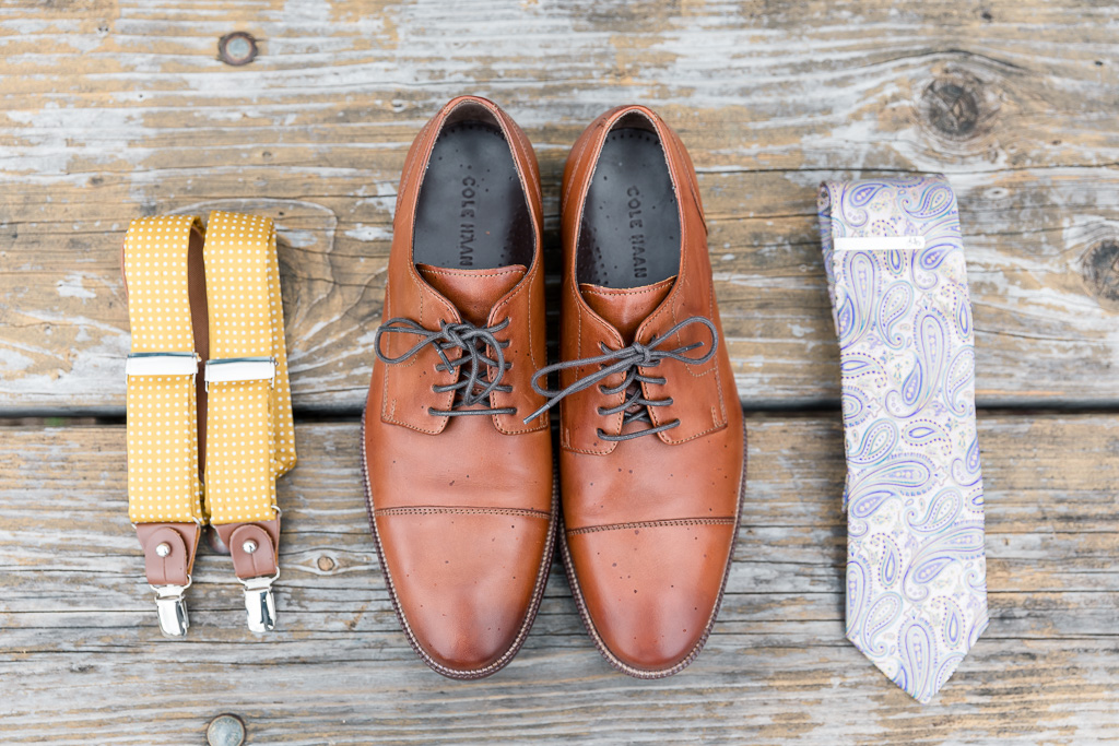 groom's details - suspenders, shoes, and tie
