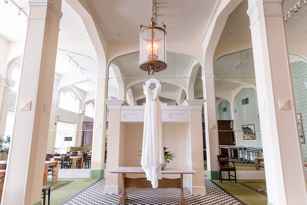 beautiful bridal reception dress hanging in Claremont Hotel & Spa