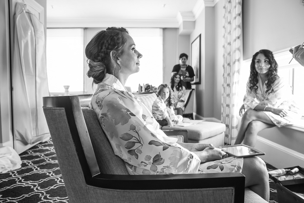 bride getting ready in her suite