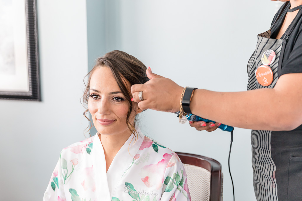 bride's hair being curled