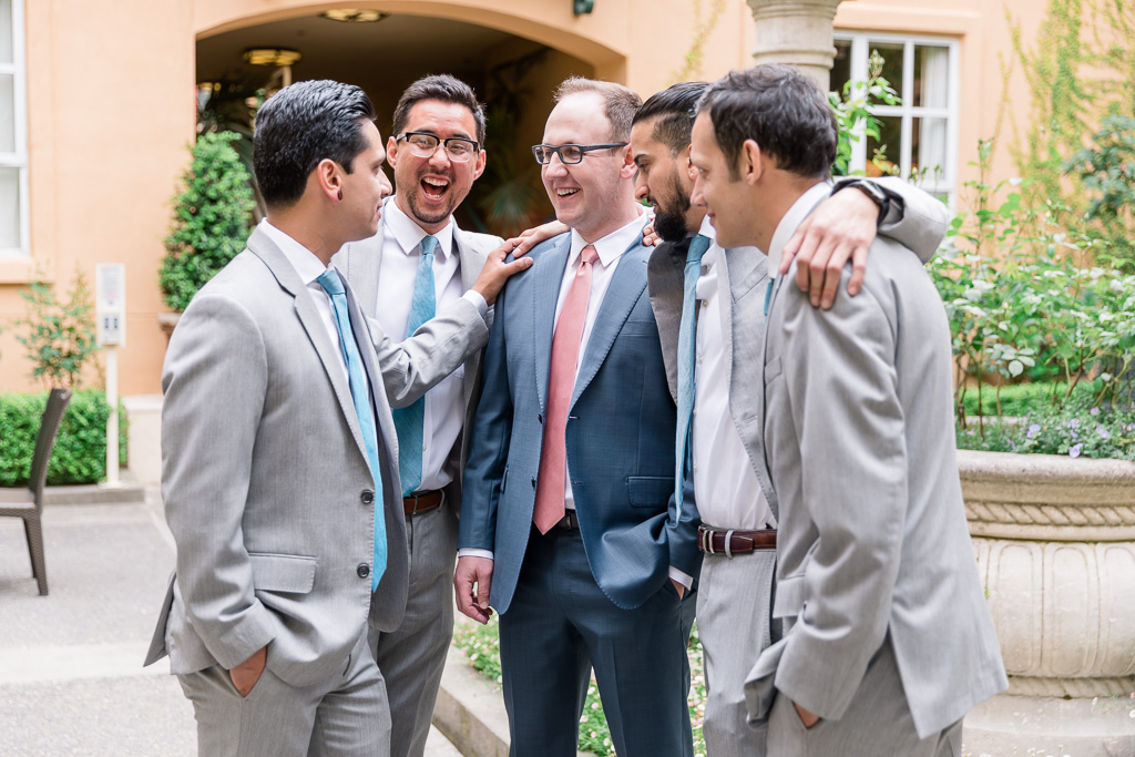 happy moment shared by the groom and his groomsmen