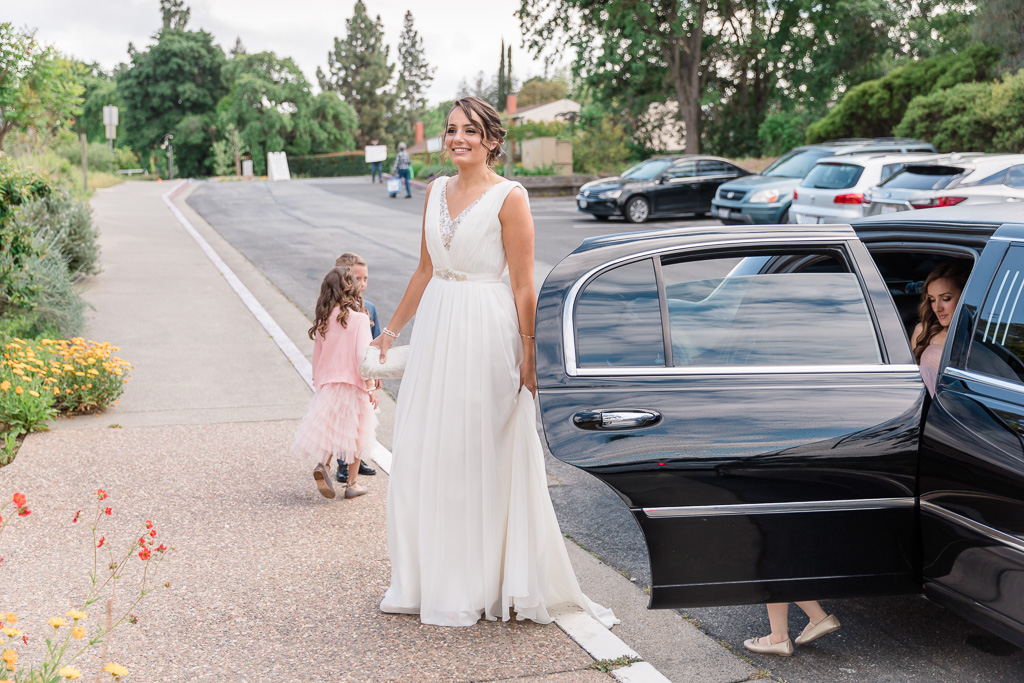 bride getting out of the limo