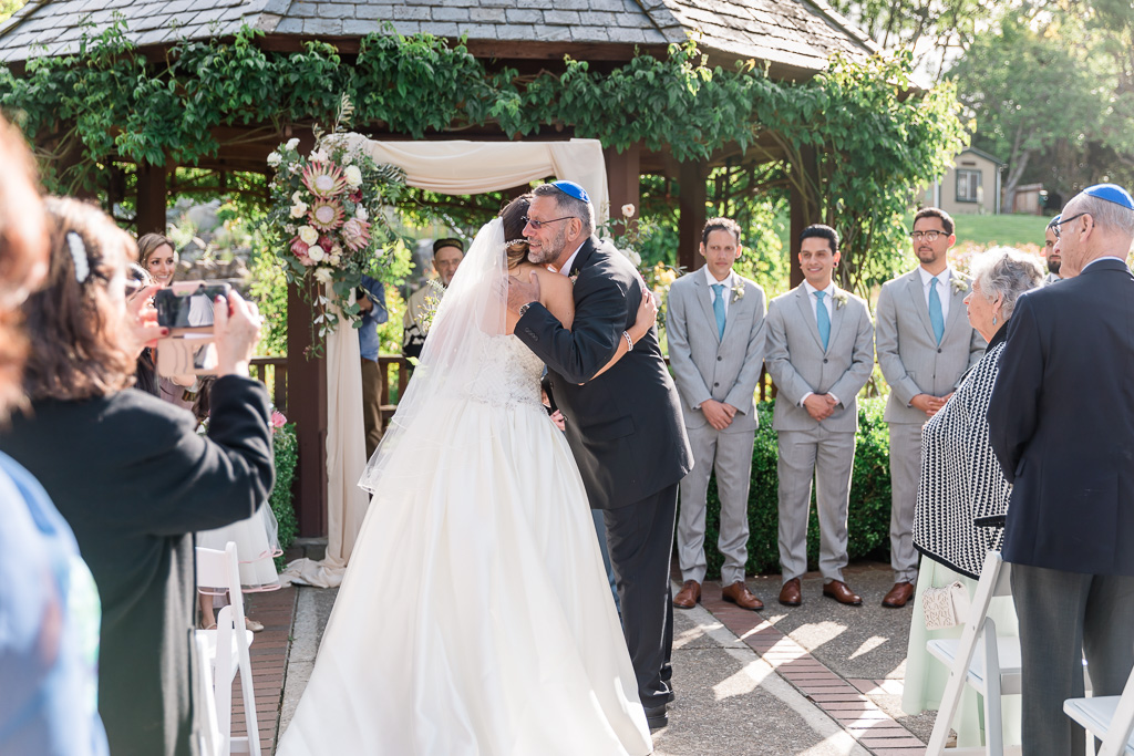bride hugging dad before he gives her away