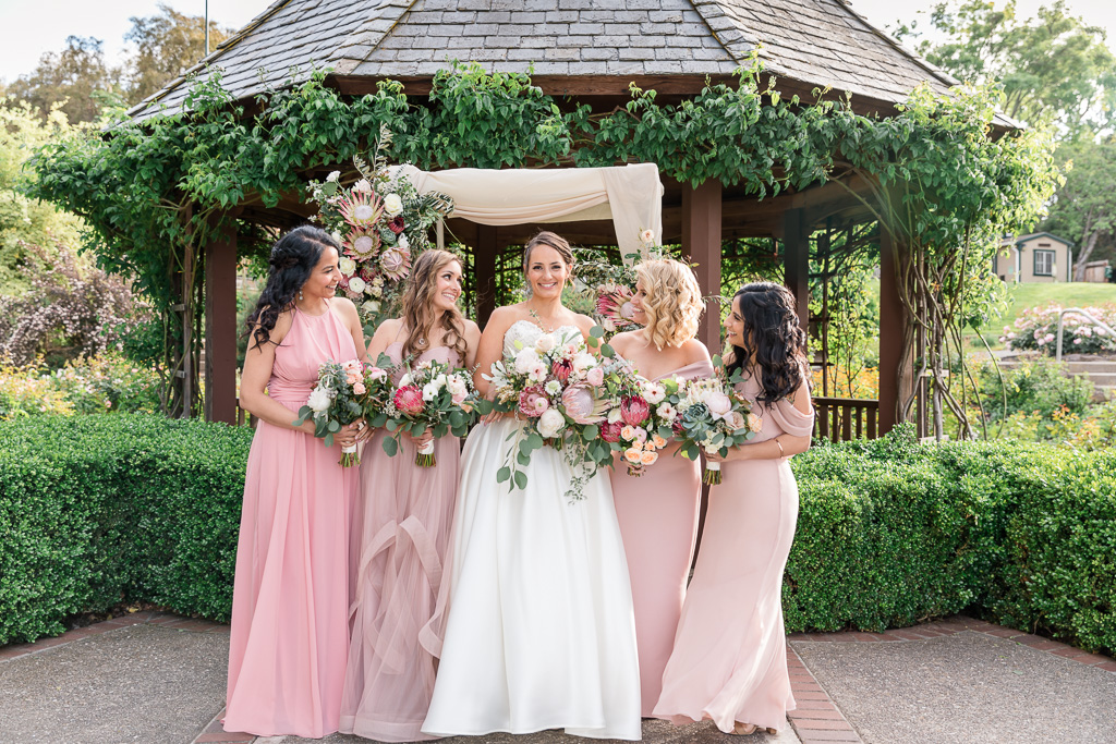 a cute bridesmaids group photo in front of the gazebo