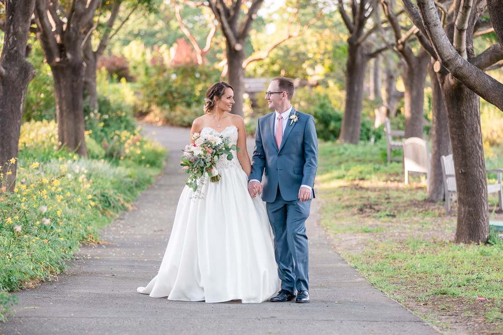 newlywed walking on a quiet path in Gardens at Heather Farm