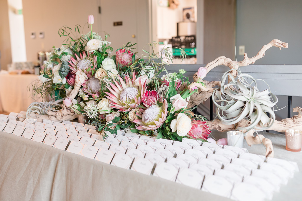 Escort card table decorated with exotic South African flowers