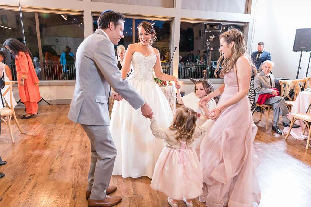 bride dancing with her family