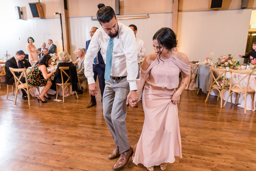 bridesmaid and groomsman owning the dance floor