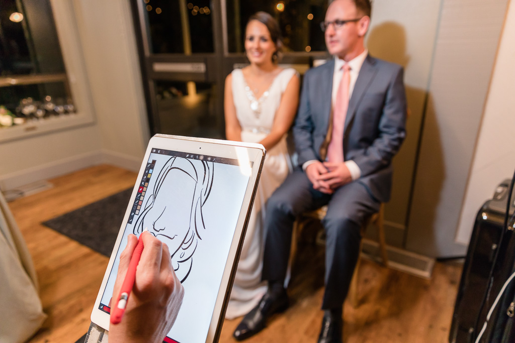Cartoonist drawing caricatures of the bride and groom