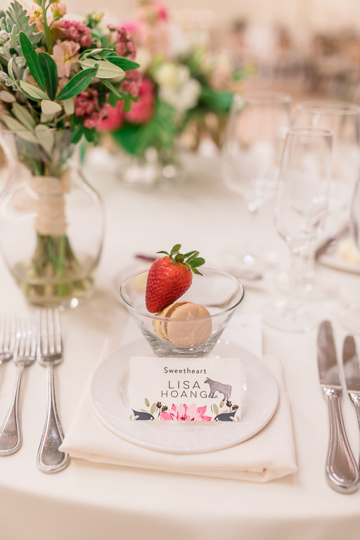 table setting with flowers, strawberry, and macaron for bride