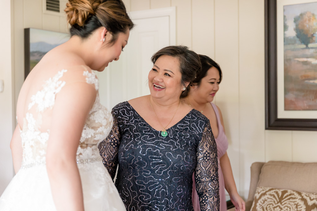mom and daughter sharing a moment before wedding