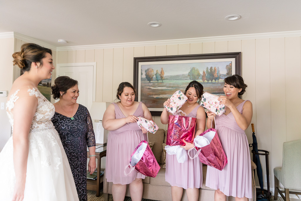 bride presenting gifts to her bridesmaids