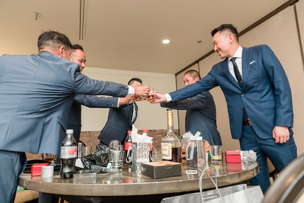 cheers - groom and groomsmen drinking whiskey before wedding