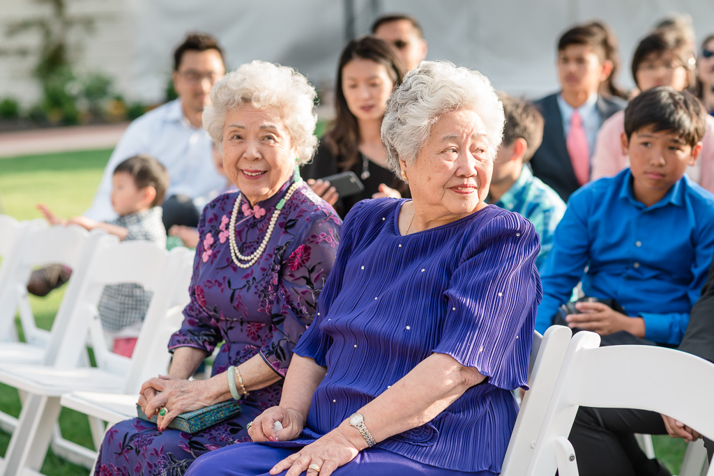 two grandmas watching during wedding ceremony