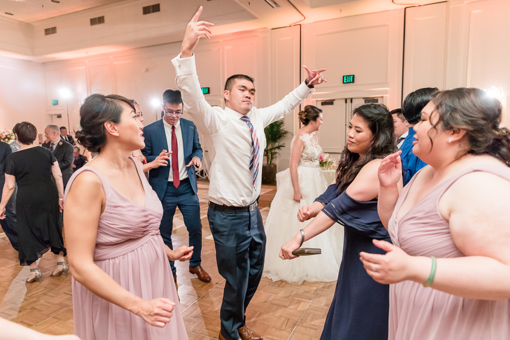 energetic guest at wedding on dance floor