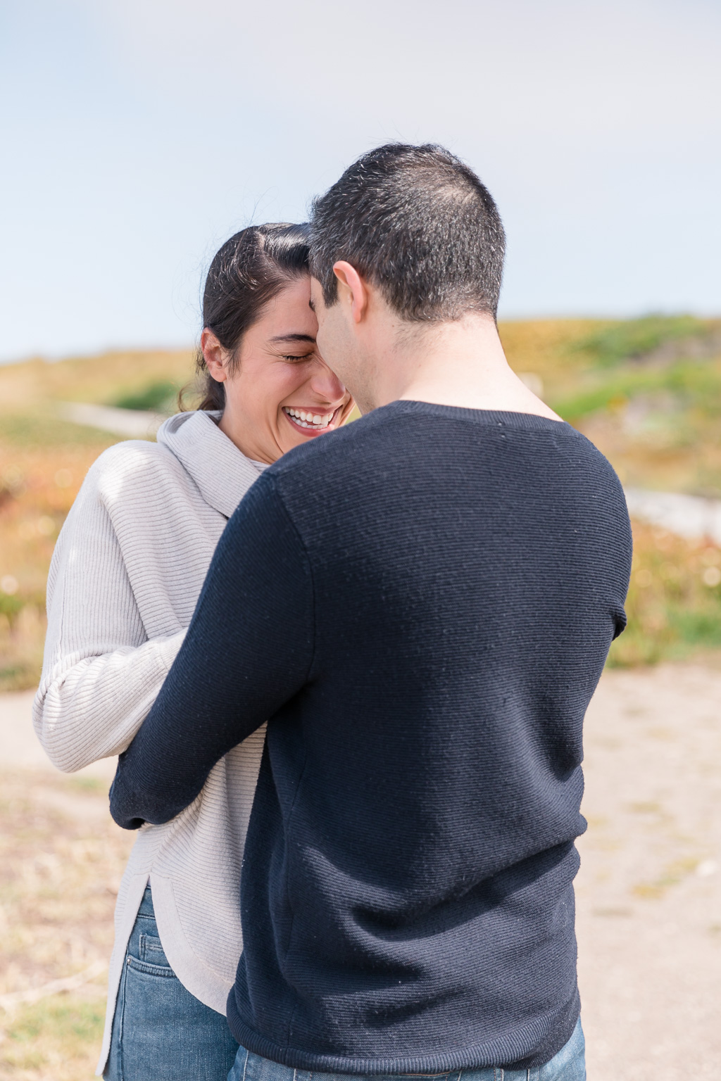 happy excited Half Moon Bay engagement photo