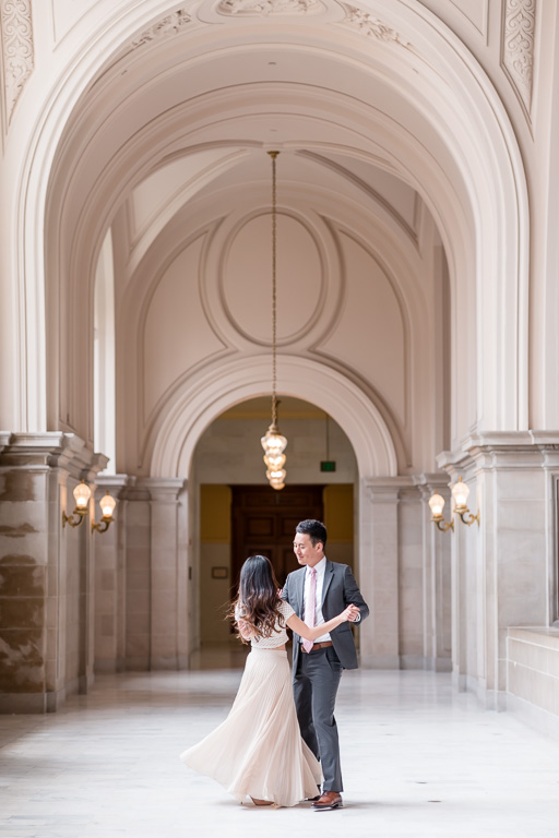 gorgeous couple dancing in the SF city hall hallway