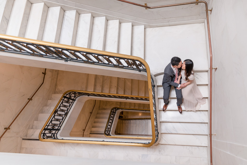 creative rectangular spiraling staircase couple portrait photo