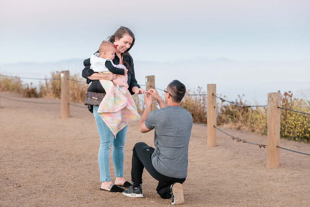 San Francisco surprise proposal with the most dreamy background - a foggy city view