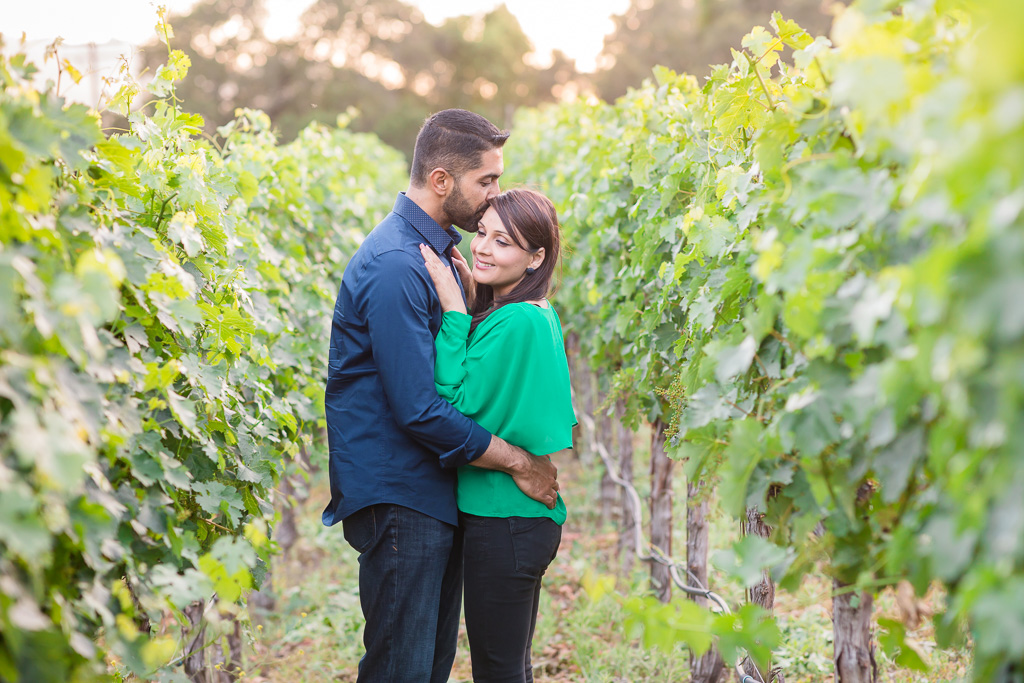 engagement couple portrait at calistoga ranch vineyard during sunset
