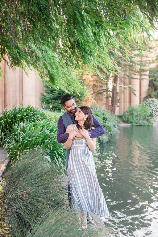 engagement photo at palace of fine arts by the pond