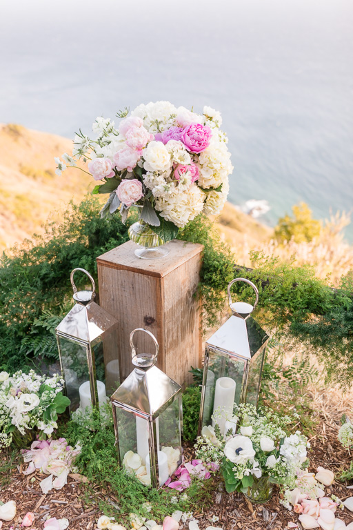 floral set up by the ocean at Post Ranch Inn for a surprise proposal