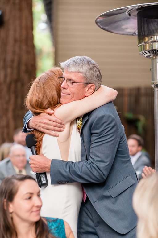 bride hugging her dad at the reception