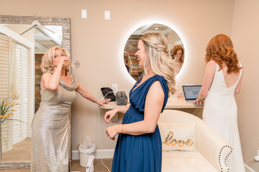 maid of honor and mother of bride having fun during getting ready