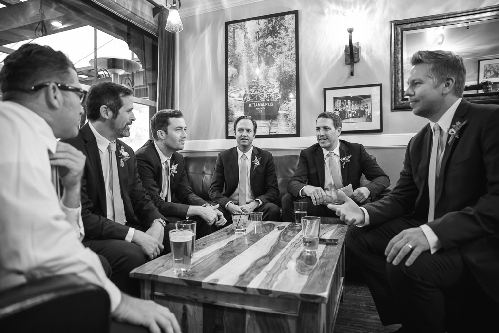 groom and groomsmen drinking at the bar