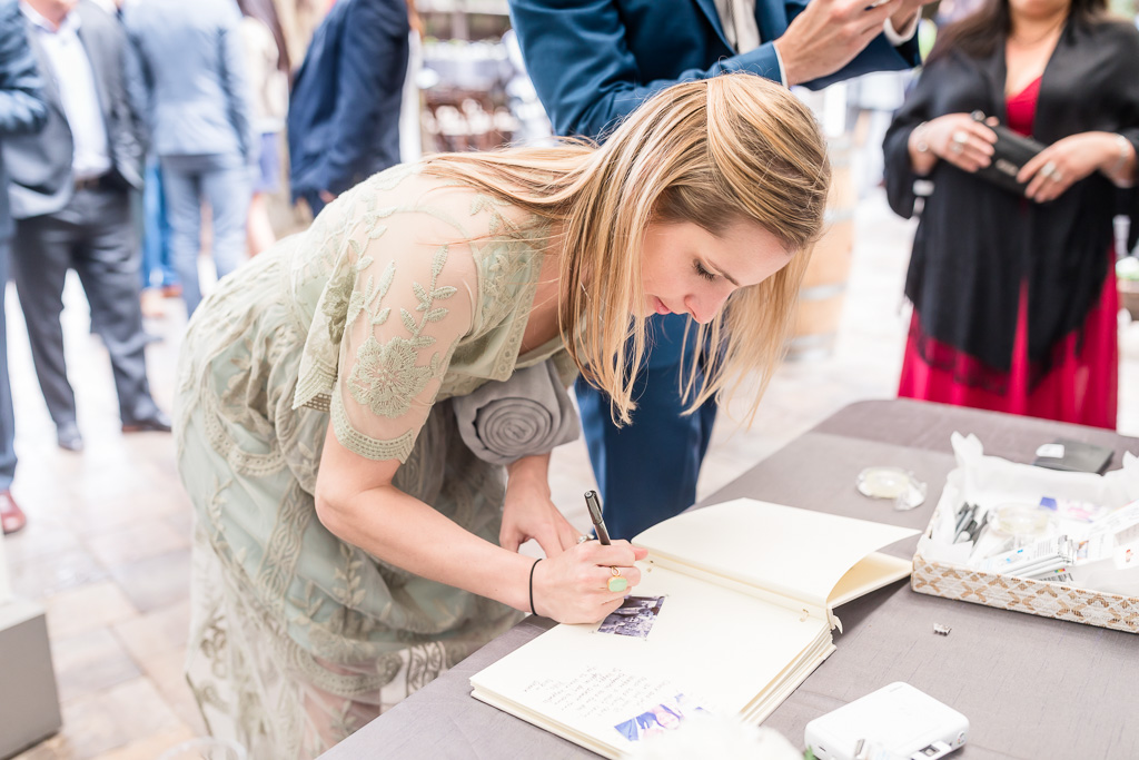 wedding guests signing the guest book