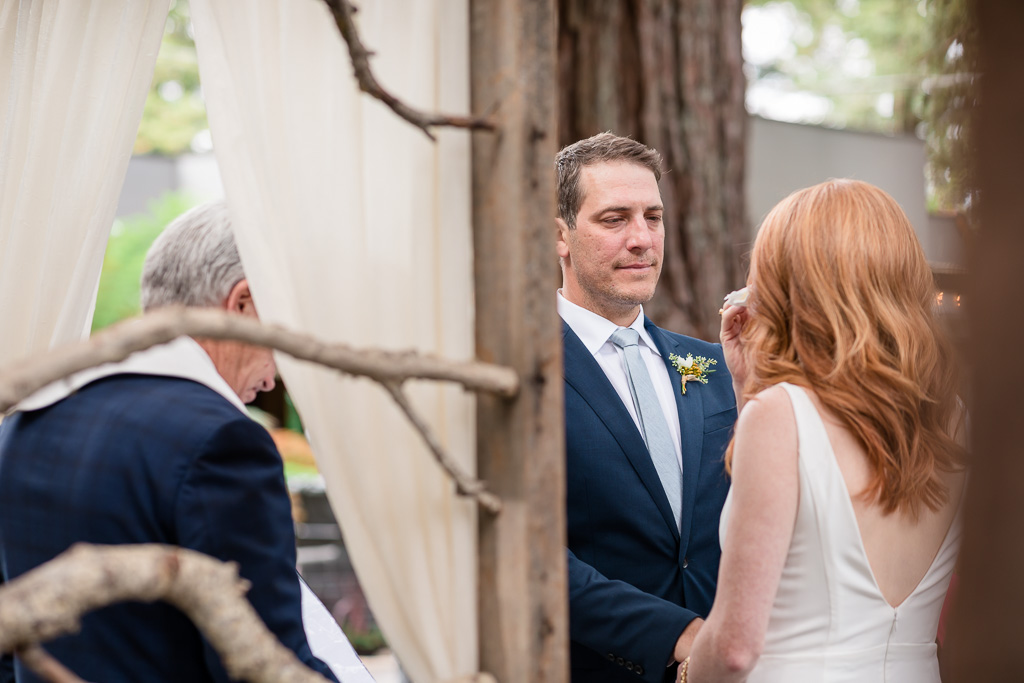 love the way the groom looks at his bride