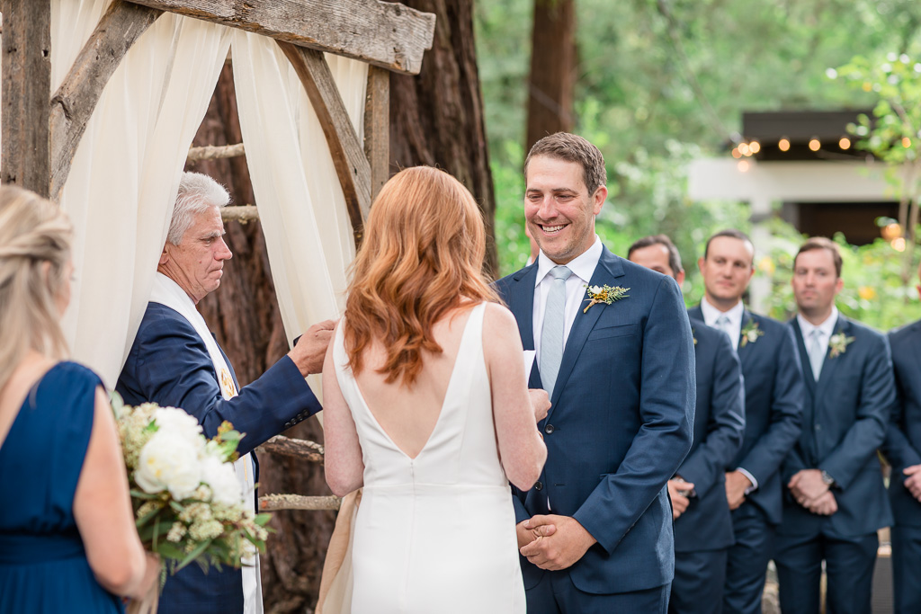 groom is very happy with his bride's vows