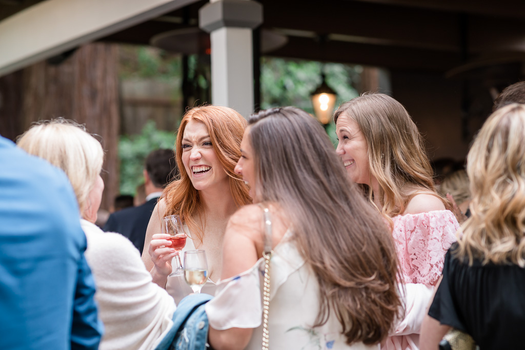 bride chatting with friends during cocktail hour