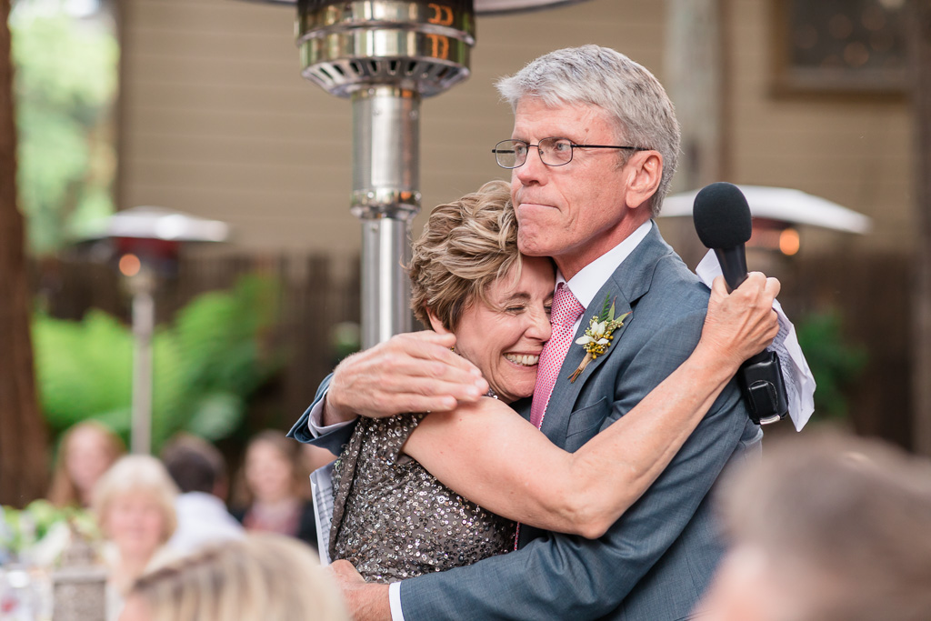 mother of the groom hugging father of the bride