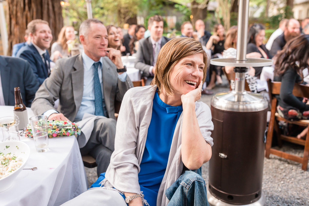 guests laughing at one of the wedding speeches