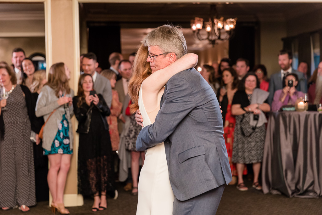 bride hugging dad after their dance