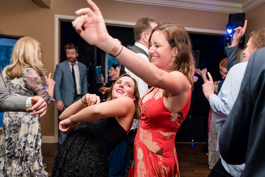 wedding guests having fun on the dance floor