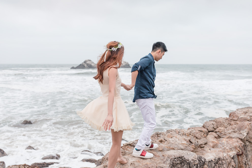 romantic and candid San Francisco engagement photo by the ocean