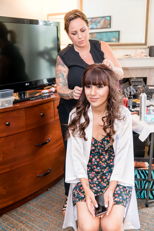 bride having her hair and makeup done at San Jose Residence Inn by Marriott