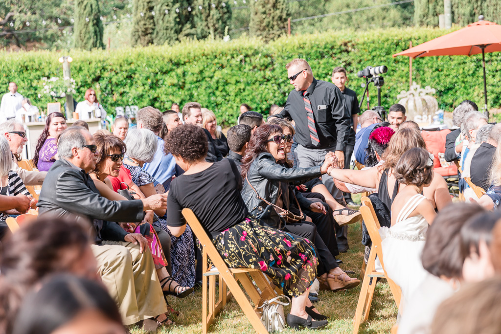 wedding guests saying hi to each other before the ceremony