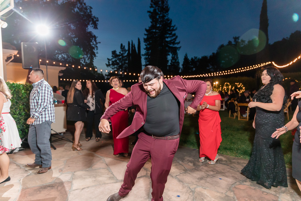 wedding guests having so much fun on the dance floor