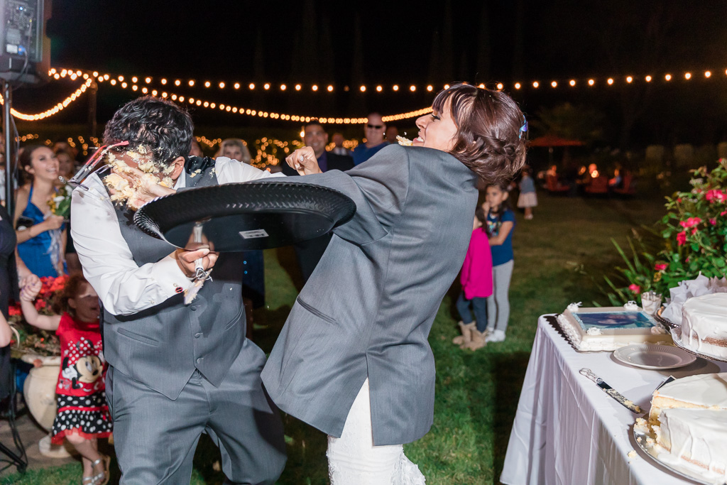 the most epic wedding cake smash ever, look at how the groom's glasses flew out of his face - Bay Area wedding phtoographer
