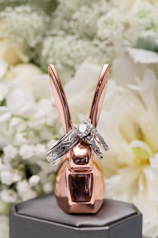 cute wedding ring shot with a metallic bunny