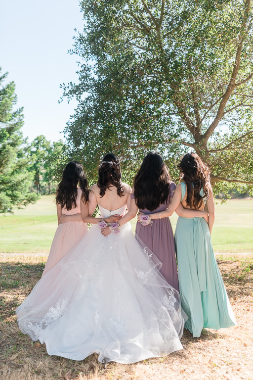 back shot of the bride and bridesmaids