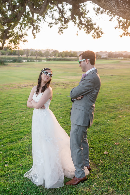 goofy bride and groom photo with their wedding sunglasses
